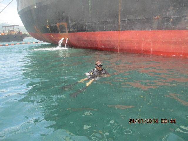 Diver Emplacing Patch on Tanker Ship Hull