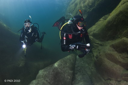 Divers in Full Length Wetsuits
